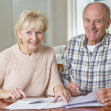 Happy Senior Couple reviewing Domestic Finances Together
